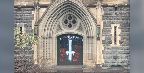 Graffiti on one of the side doors at St Patrick's Cathedral (Melbourne Archdiocese)