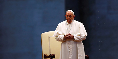 Pope Francis leads a prayer service in an empty St Peter's Square at the Vatican on March 27 (CNS/Yara Nardi, pool via Reuters)