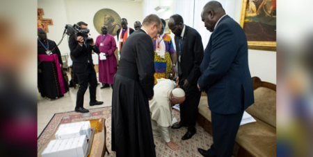 Pope Francis kneels at the feet of Sudanese leaders at the Vatican last year in an appeal for peace (CNS Vatican Media via Reuters)