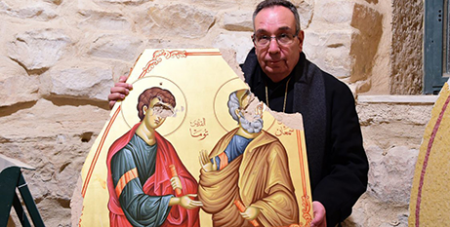 Archbishop Jean Abdou Arbach with an icon destroyed in Syria by Islamist militants in April 2018 (ACN)