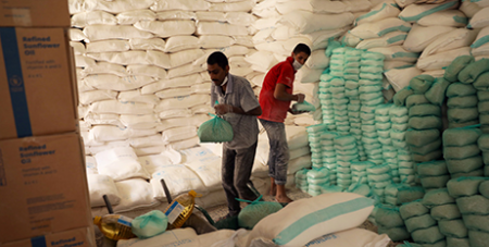 Workers prepare food at a distribution centre supported by the World Food Program in Sanaa, Yemen, June 3, 2020 (CNS/Khaled Abdullah, Reuters)