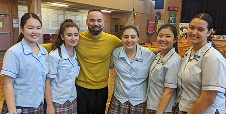 Gary Pinto performed his Project Compassion song at St Mary's Cathedral College earlier this year (Caritas Australia/Daniel Nour)