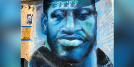 A painting of George Floyd on a wall in Minneapolis (CNS/Maria Wiering/The Catholic Spirit)