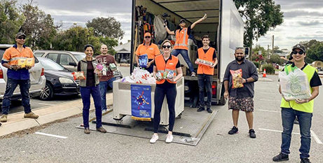 Members of Rotary and Knights of the Southern Cross collected 3200kg of food (Supplied)