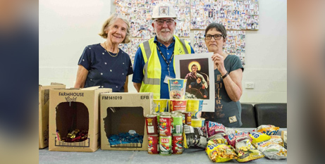 Deacon Patrick Moore with wife Carol and volunteer Marianne from Palmyra Parish with the gift bags being assembled for seafarers (The eRecord/Eric Martin)