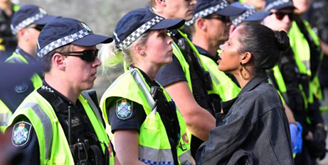 A protester confronts police during a Black Lives Matter protest in Brisbane on Wednesday (CNS/Darren England/AAP Image via Reuters)