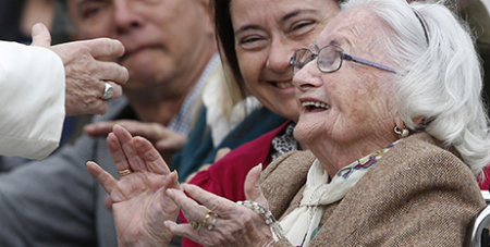 An elderly woman meets Pope Francis during a general audience at the Vatican (CNS/Paul Haring)