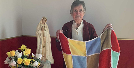 Barbara Tifere with one of the blankets donated for bushfire survivors in East Gippsland (Sale Diocese)