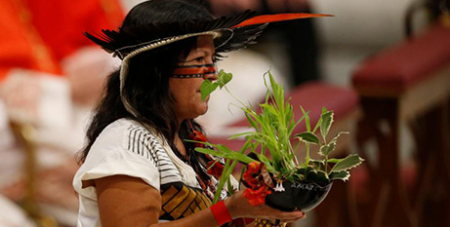 An indigenous representative from Brazil in the offertory procession at the final Mass of the Amazon Synod in October 2019 (CNS/Paul Haring)