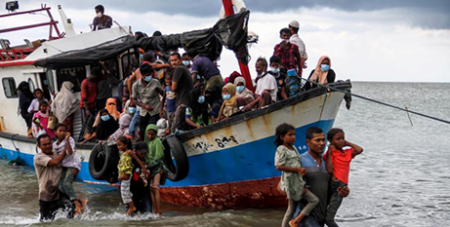 Rohingya refugees are evacuated from a boat by locals in Aceh, Indonesia on June 25 (CNS/Antara Foto, Rahmad via Reuters)