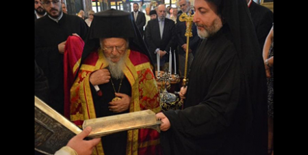 Ecumenical Patriarch Bartholomew of Constantinople receives the reliquary on June 30 in Istanbul, Turkey (CNS/Ecumenical Patriarchate of Constantinople)