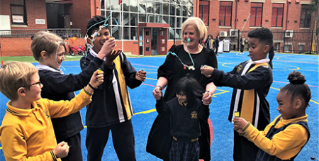 Students at St Michael's North Melbourne celebrate National Primary Principals Day with principal Denise Hussey (MACS)