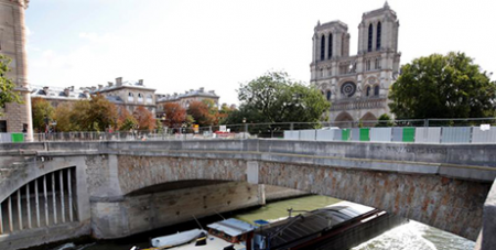 Fences surround Notre Dame Cathedral in Paris on Tuesday in preparation for a lead decontamination operation (CNS/Charles Platiau, Reuters)