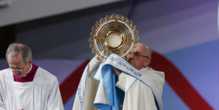 Pope Francis holds up a monstrance during Eucharistic Adoration at 2019 World Youth Day in Panama City, January (CNS/Paul Haring)
