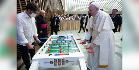 Pope Francis plays foosball after the papal audience on Wednesday (CNS/Vatican Media)