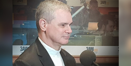 Archbishop Peter A. Comensoli in the 3AW Radio studios yesterday (3AW)