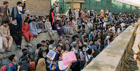 Crowd outside the airport in Kabul on Wednesday (CNS/Twitter/David Martinon via Reuters)