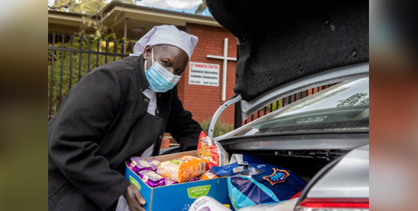 Anna Dimo, at the St Bakhita Centre in Homebush, prepares to distribute goods to COVID-affected people (The Catholic Weekly/Giovanni Portelli)