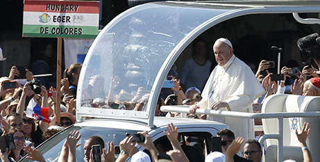 Pope Francis greets the crowd before celebrating the closing Mass of the International Eucharistic Congress in Budapest, Hungary, yesterday (CNS/Paul Haring)