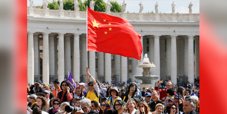 A man waves China's flag during Pope Francis