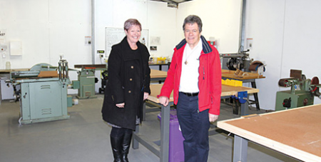 Donna Cooper and Fr John Curtis CP from The Monastery inside the recently renovated Men's Shed (The Southern Cross)
