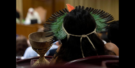 An indigenous person attends a session of the Synod of Bishops for the Amazon at the Vatican yesterday (CNS/Vatican Media)