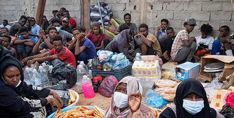 Migrants wait outside the UN High Commissioner for Refugees negotiation office in Tripoli, Libya, on October 9 (CNS/Nada Harib, Reuters)
