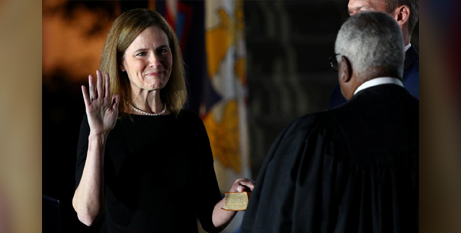 Amy Coney Barrett is sworn in by Supreme Court judge Clarence Thomas at the White House on Monday (CNS/Tom Brenner, Reuters)