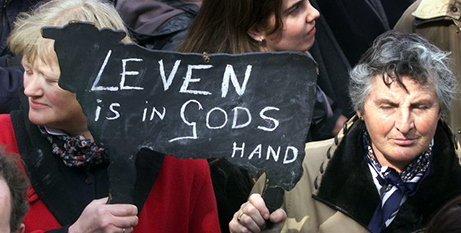 Women opposed to euthanasia in the Netherlands hold a sign that says 'Life is in God's hands' (CNS/Michael Kooren, Reuters)