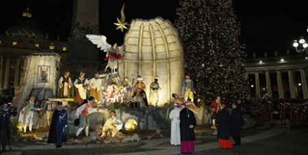 Pope Francis visits a Nativity scene displayed in St Peter's Square in 2017 (CNS/Paul Haring)