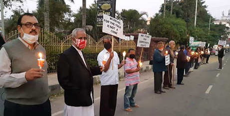 Catholic priests and religious join a candlelight protest in India's Assam state on December 10 calling for the release of Fr Stan Swamy SJ (UCA News)